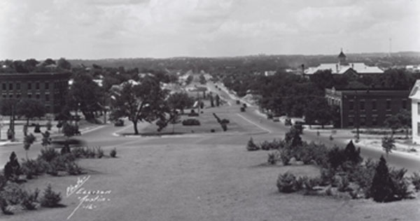 Looking south along East Avenue (now I-35) from 12th St. after a paving project. St. Edward's University can be seen on the horizon. Ellison Photo Co. / The Portal to Texas History.
