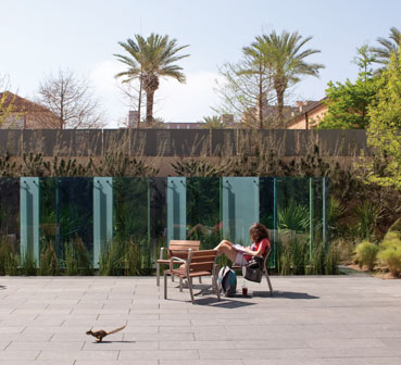 A study in contrasts, squirrel and student alike enjoy the sunny spaces of the Ellen Clarke Temple East Garden and the Frances Brannen Vick West Garden located outside the Julius Glickman Conference Center on the building's south side.