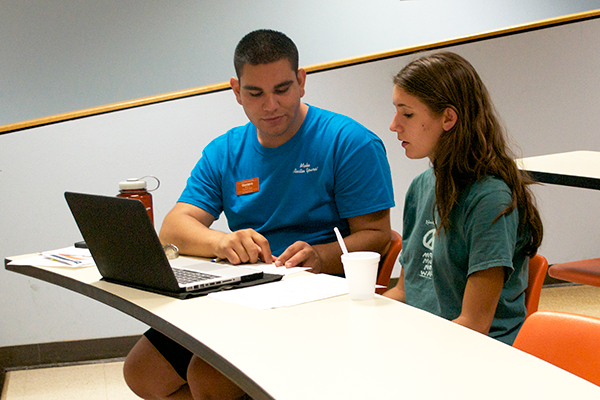 Gustavo Molinar advises an incoming liberal arts freshman about her fall schedule.