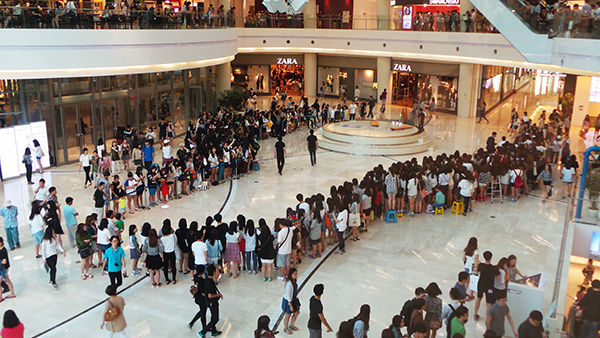 K-Pop fans gather an hour before an autograph event (fansign). Fans are a huge part of K-Pop and this sort of connection-building interaction is very important to its success, Lovelace says.
