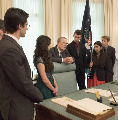 Larry Temple (center) speaks with Larry Temple Scholarship winners during a tour of the LBJ Library Oval Office replica on Jan. 19, 2016. Photo: Jay Godwin