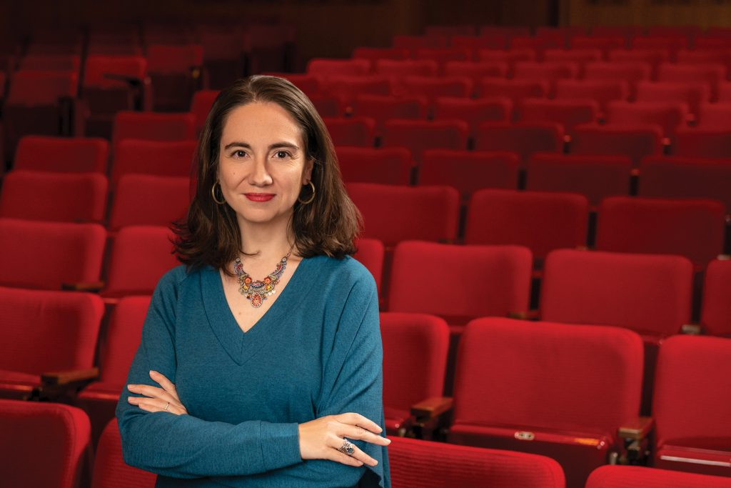 Donna Kornhaber standing in an empty movie theater.