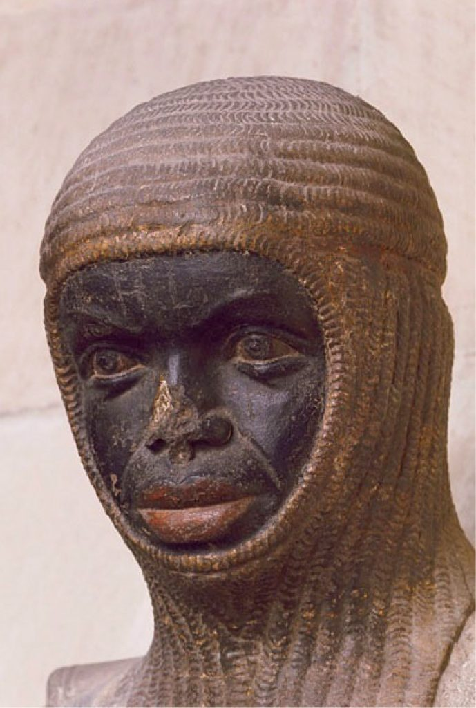 Detailed statue of an African man's face wearing a head covering.