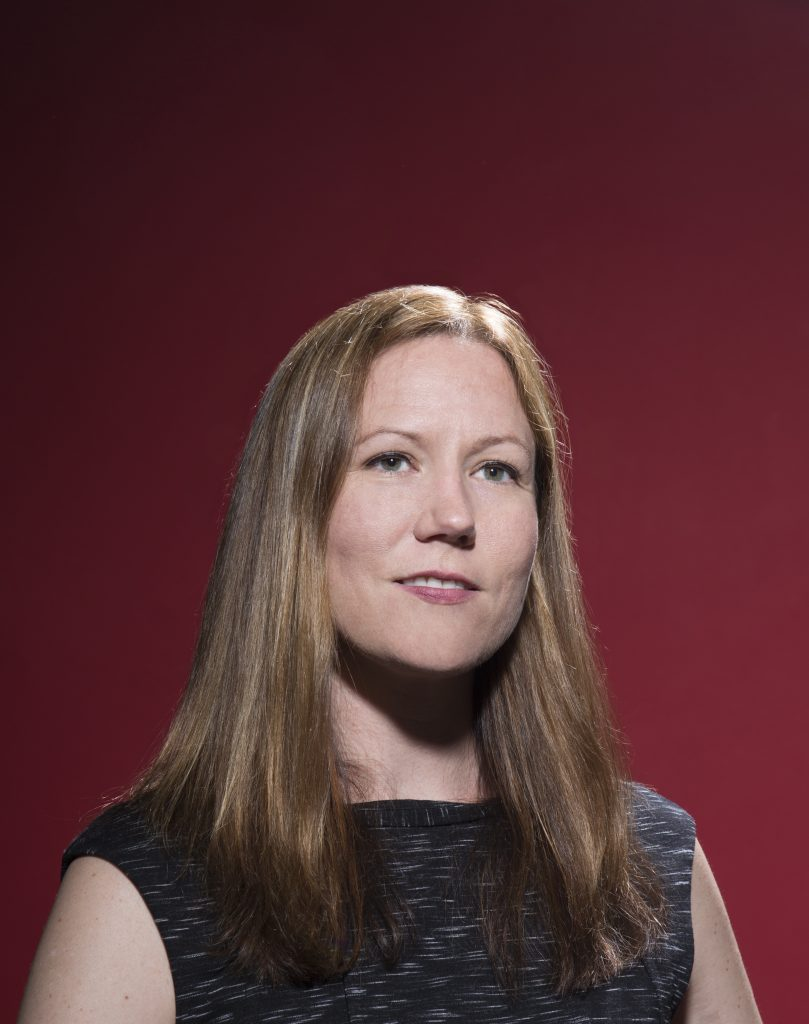 Portrait of Bethany Albertson against a red background.