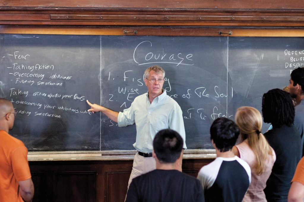 Daniel Bonevac, professor of philosophy and Human Dimensions of Organizations gives a lesson to students before a blackboard.