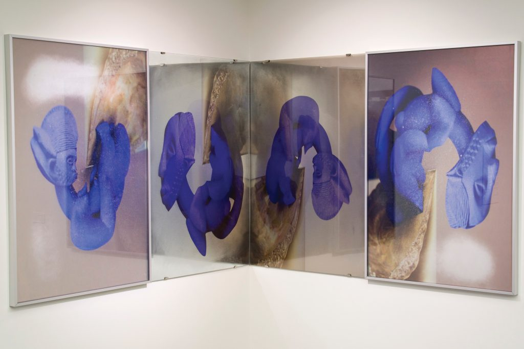 Photographs of Untitled 123 and 4, 2016 by Angelbert Metoyer. Purple-colored sculptures of figures in various poses.