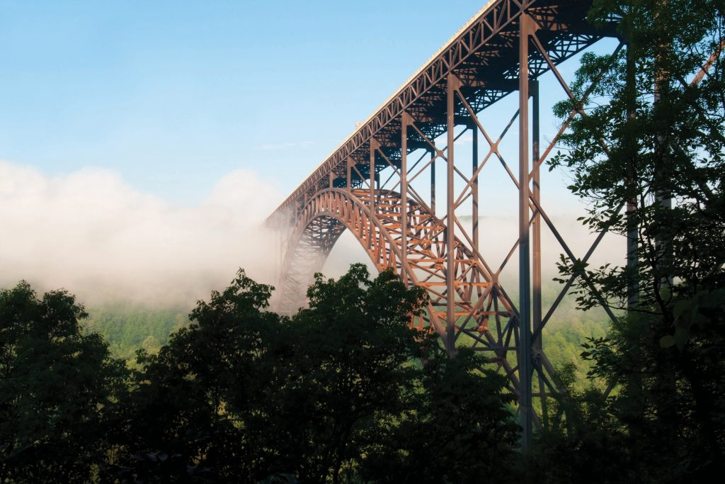 New River Gorge Bridge located in Fayetteville, West Virginia extends 3,030 ft. across. When it opened in 1977, it was the highest vehicular bridge in the world. It is currently the third highest bridge in the United States and the fourth longest arch bridge in the world. Photo by Shutterstock.