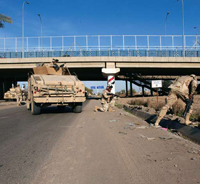 U.S. soldiers from the Fighting 69, a New York National Guard unit, shut down Route Irish, the highway between Baghdad International Airport and central Baghdad, on a mission to search for possible Improvised Explosive Devices (IEDs)