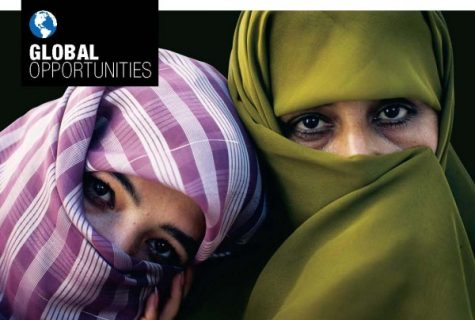 Close-up of two women wearing veils that cover their heads leaving only their eyes visible