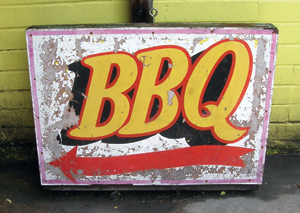 sign pointing the way to BBQ