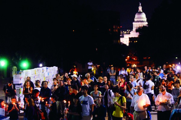 group gathered at night outside of capital