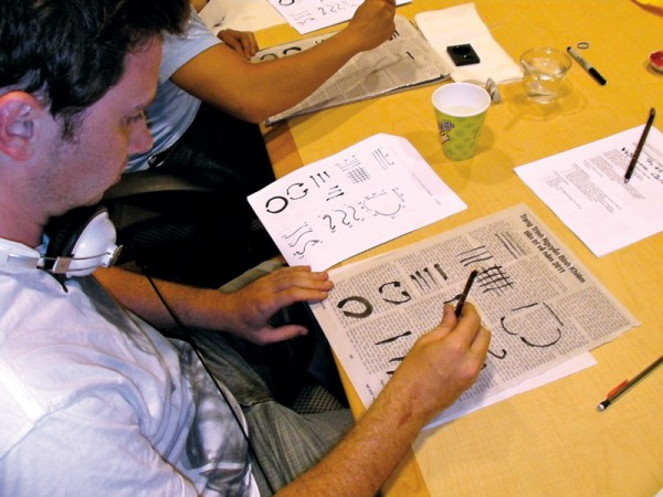 A student practices calligraphy at a weekly guest lecture with local Vietnamese artist Duong Phuoc Luyen. Courtesy of the Summer Language Institute