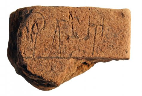 A 2-inch by 3-inch tablet was discovered in Iklaina, Greece. It's the oldest known tablet in Europe. The back of the tablet is pictured. Photo by Christian Mundigler, courtesy of the University of Missouri–St. Louis
