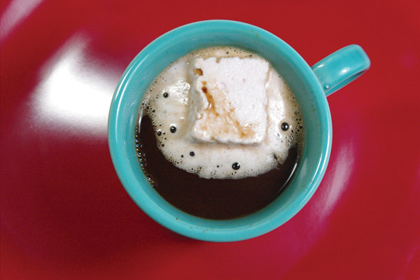 Hot beverage in a mug, with a large floating marshmallow.