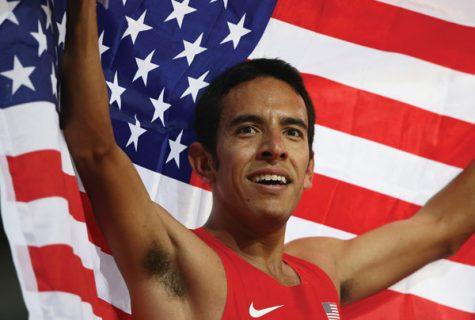 Leo Manzano holding American flag.