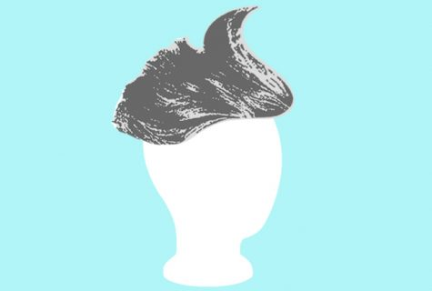silver wig on blank head on blue background
