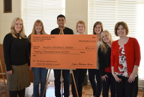 From left: Lauren Thomas (ACS rep), Emma Lindrose (ACS rep), Maurice Bell, Thomas Cardwell, Rachel Clyde, Hannah Mahanay, Pam Paxton holding a check