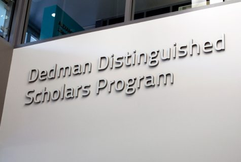 Dedman Distinguished Scholars Program signage in silver lettering located in the College of Liberal Arts Building.