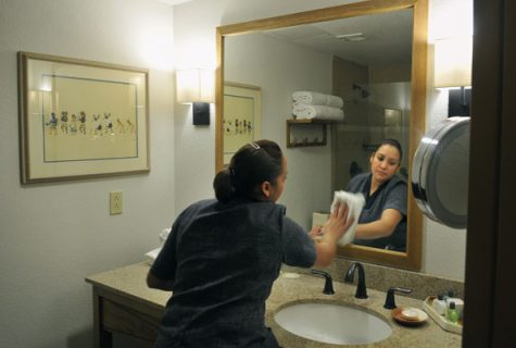 Luz Torres, a housekeeper at the Eldorado Hotel in Santa Fe, New Mexico, cleans one of the hotel's rooms in December 2011. Torres is paid more than Santa Fe's minimum wage.
