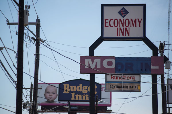 Signs of a struggling neighborhood; old economy motels line the area of Rundberg and I-35.