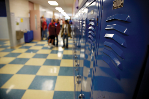 highschool hallway with blue lockers