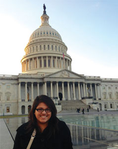 Photo of Cristina Flores in front of Washington Capitol building.