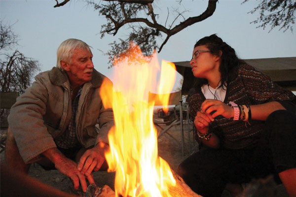 Geography senior Jessica Alvarenga engages in a fireside chat with safari guide Daryl Dandridge (left) after a full day of field research in Botswana, Africa. Photos: Courtesy of the Botswana Study Abroad Program