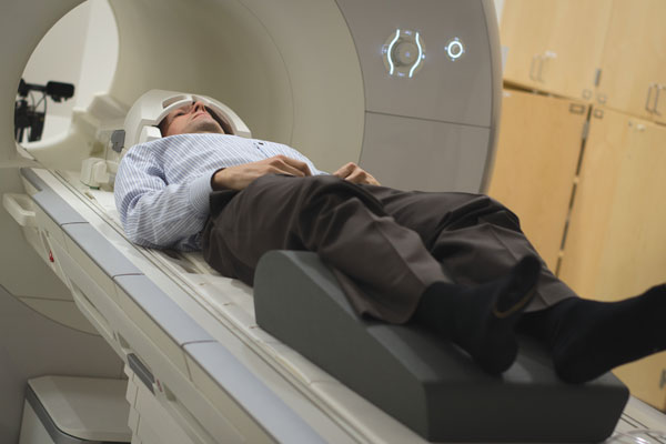 Russell Poldrack undergoes his weekly magnetic resonance imaging (MRI) scan. Poldrack's brain was scanned more than 100 times. Photo by Alexander Wang.