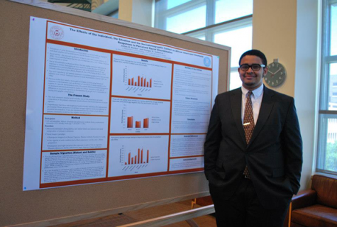 student in front of presentation poster