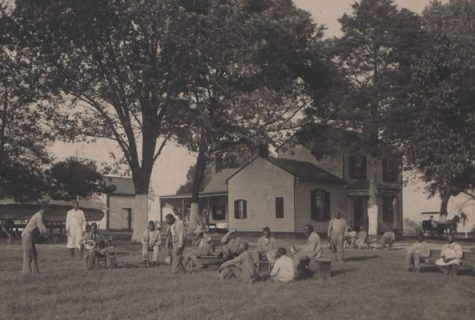 the institution, people lounging on yard