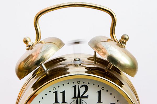 top half of golden alarm clock