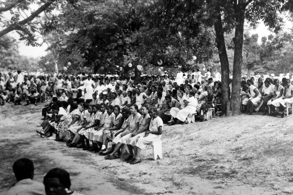 May Day festival, circa mid-1950s; patients listen to a musical performance.