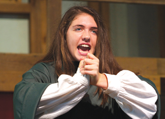 A young player performing during Camp Shakespeare at the Winedale Theatre Barn. Photo: Caroline Poe.