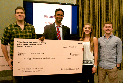 Student advocates for Caring for Cambodia present the organization's founder and CEO, Jamie Amelios, with a check.