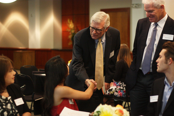 Dean Randy Diehl greets DDG Rebekah Rodriguez and her family at the luncheon Thursday.