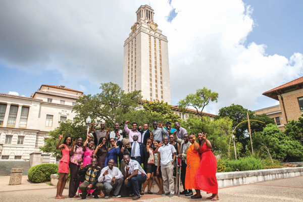 Twenty-five Washington Fellows pose in front of the UT Tower on their first day on campus