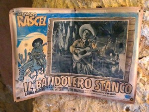 Old movie flyer for the Teatro Communale on display in make-shift community museum in Sicily