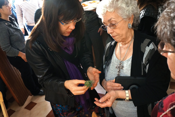 Texas relatives learning to make ornamental roses from artichokes at the Fazzino family altar
