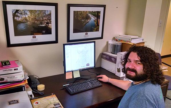 Garza at his desk at the El Camino Real office.
