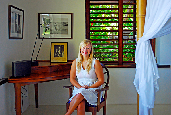 Saastamoinen sitting at Ian Fleming's writing desk in his home, 'Goldeneye,' in Jamaica, where he wrote the James Bond novels.