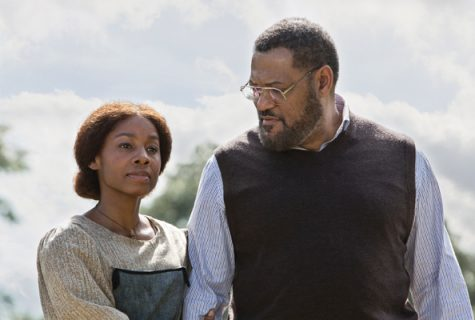 "Photograph from the remake of the miniseries, ""Roots."" Anika Noni Rose (Kizzy) and Laurence Fishburne (Alex Haley)."