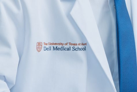 close up of lab coat with Dell Medical School logo