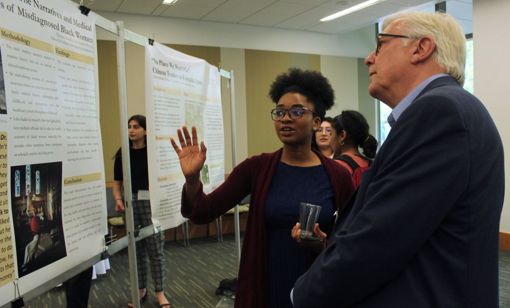 Thomaia Pamplin explains her research poster to Randy Diehl.