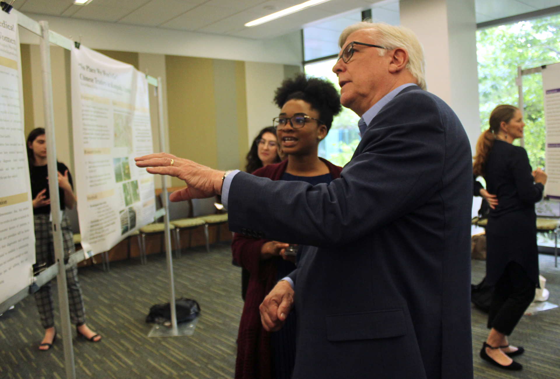 Dean Randy Diehl gestures at the poster of Tomaia Pamplin during the event.