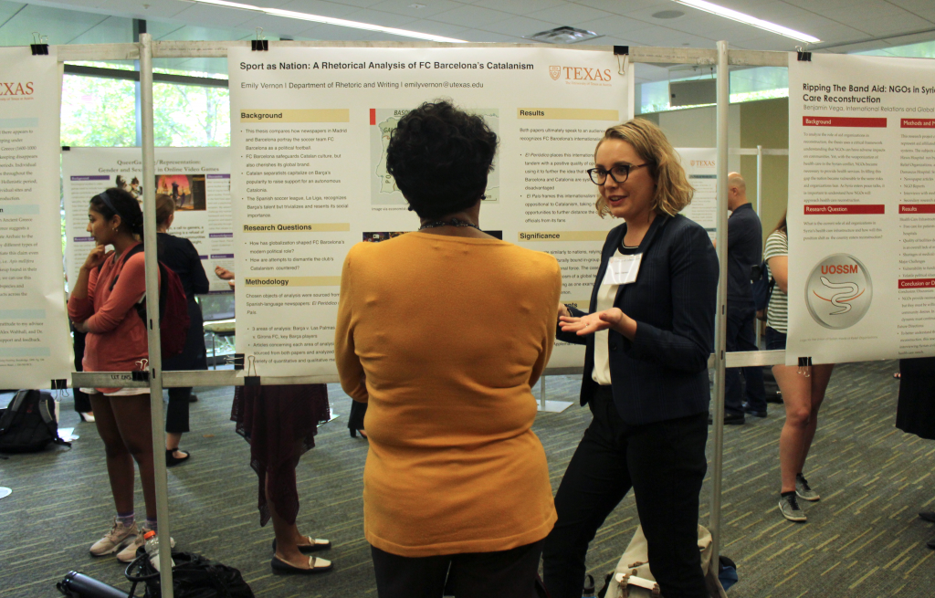 Emily Vernon discusses her research poster.