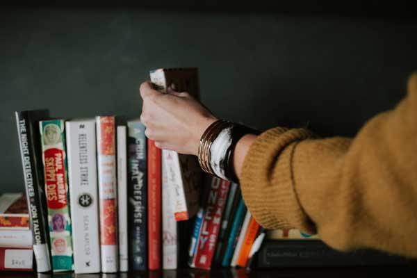 hand grabbing a book.