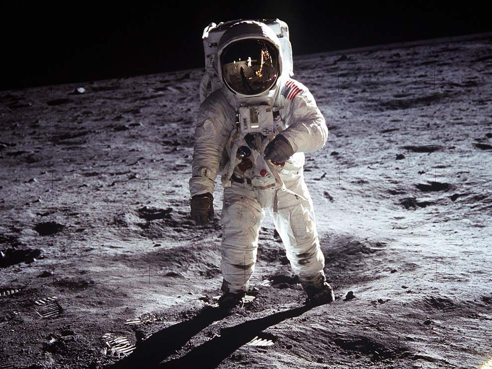 U.S. astronaut in space suit standing on the moon.