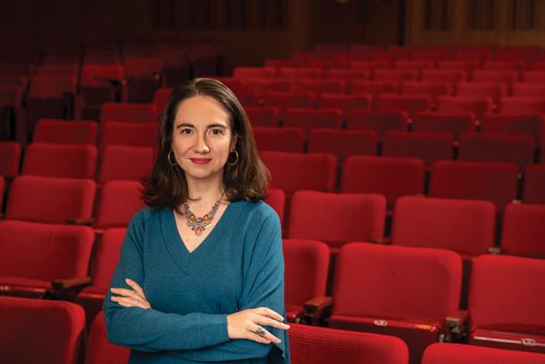 Donna Kornhaber standing in an empty movie theater