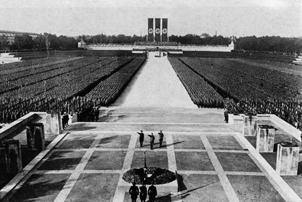 a Nazi demonstration with thousands of people lined up at a square