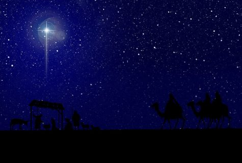 blue sky filled with stars and one bright northern star with nativity scene silhouette beneath